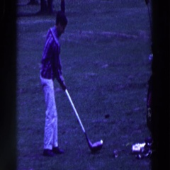 1961: man carefully swinging oversized golf club, nearly falls over RIDGEFIELD Stock Footage