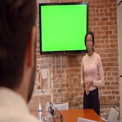 Businesswoman Standing By Screen To Deliver Presentation Stock Footage