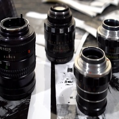 Vintage 35mm cameras, lenses, photos and film are piled up. Stock Footage