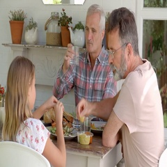 Same Sex Family At Home Eating Meal On Outdoor Verandah Stock Footage