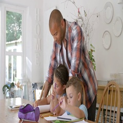 Father Helping Children With Homework At Table Stock Footage