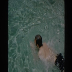 1961: man swimming back and forth in a swimming pool. NORTH HOLLYWOOD Stock Footage