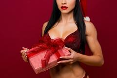 Crop female breast in re bra Stock Photos