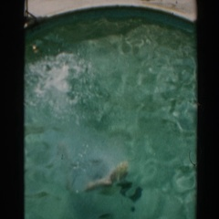 1961: a kid try to swim with his father NORTH HOLLYWOOD, CALIFORNIA Stock Footage