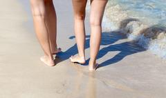 Tanned sexy legs on the beach Stock Photos