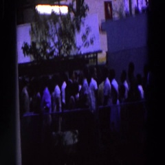 1964: a large group of people standing in line behind a fence  Stock Footage