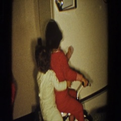 1958: children playing on a small bicycle. ALIQUIPPA, PENNSYLVANIA Stock Footage