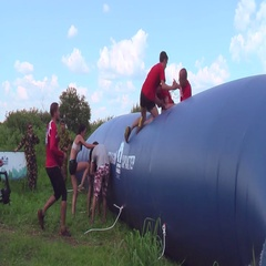Athletes overcome inflatable obstacle. Tyumen Stock Footage