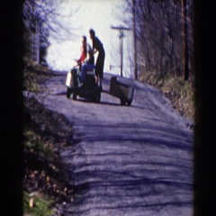 1964: family taking a ride on a lawnmower down the driveway. PEQUOT LAKES Stock Footage