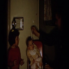 1958: a father grooming a baby while his other kids look on ALIQUIPPA Stock Footage