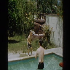 1961: a boy jumping into a body of water that is outside NORTH HOLLYWOOD Stock Footage