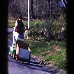 1964: quaint driver straddles lawnmower with cart. PEQUOT LAKES, MINNESOTA Stock Footage