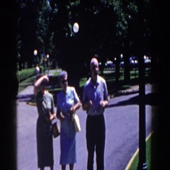 1958: three people of a certain age taking a walk at the park Stock Footage