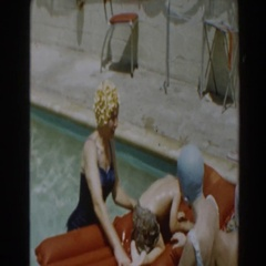 1961: a kid on an inflatable raft at the swimming pool NORTH HOLLYWOOD Stock Footage