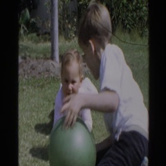 1964: children playing with a ball in the grass. NORTH HOLLYWOOD, CALIFORNIA Stock Footage