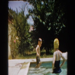 1961: mother playing with her son in the swimming pool. NORTH HOLLYWOOD Stock Footage