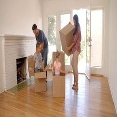 Children In New Home Playing With Boxes On Moving Day Stock Footage