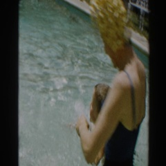 1961: mother and son playing in a swimming pool. NORTH HOLLYWOOD, CALIFORNIA Stock Footage