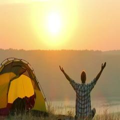 4K  Sunrise, lake and man traveller meditates near tent Stock Footage