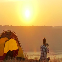 4K  Tent,  sunrise and man traveller  does  photo by smartphone Stock Footage