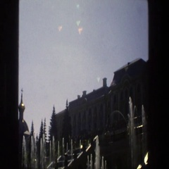1975: a water fountain in front of a building lined with windows DENMARK Stock Footage