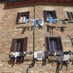 Laundry hanging out on a facade in Italy Stock Footage