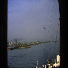 1975: birds fly in circles above the water near a ship DENMARK Stock Footage