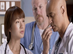 Medical staff consult together while looking at computer tablet 4K Stock Footage
