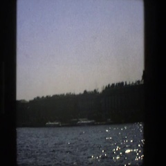 1975: boat in the distance, travelling across the lake on a sunny day. DENMARK Stock Footage