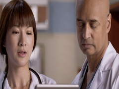 Medical staff have discussion while looking at computer tablet 4K Stock Footage