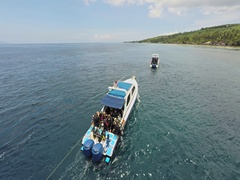 Aerial shot of divers on a speed boat on the coast of Nusa Penida, Bali Stock Footage