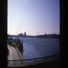 1975: view of town surrounded by water and green vegetation STOCKHOLM Stock Footage