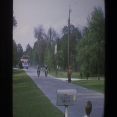 1973: men riding motorcycle down the road WALT DISNEY WORLD FLORIDA Stock Footage