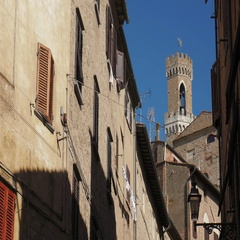Palazzo dei Priori palace tower in Volterra, seen from the streets Stock Footage
