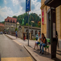Driving in a car across one of the Three Bridges in the city center of Ljubljana Stock Footage