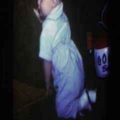 1973: baby crawls to chair to use for support to stand and walk a few steps Stock Footage