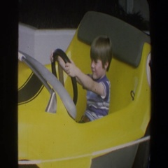 1973: small child pretending that he's driving. WALT DISNEY WORLD FLORIDA Stock Footage