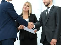 Handshake to seal a deal after a job recruitment meeting in a of Stock Photos