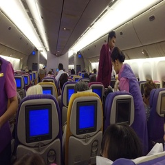 Airplane crew serve airplane passengers Stock Footage
