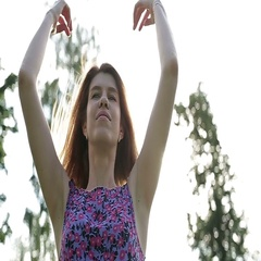 The girl develops her hair blowing in the breeze on a summer day Stock Footage
