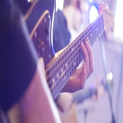 Playing electric guitar close-up slow motion. Guitarist hands pressing chords Stock Footage