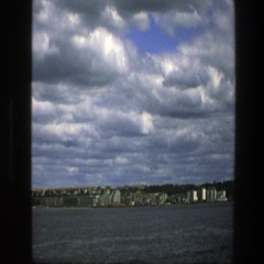1975: quiet moments looking at a wide space of water  Stock Footage