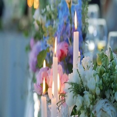 Candles and flowers set for wedding eception banquet blur background close up Stock Footage