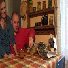 Couple prepare dried linden blossom tea in rural kitchen. 4K Stock Footage