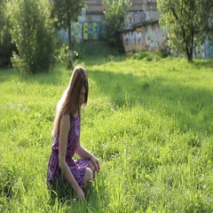 Girl on spring lawn Stock Footage