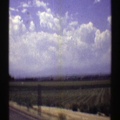 1969: looking out the window of a car across empty fields along the roadsides Stock Footage