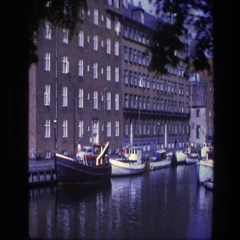 1975: the canal of the city with many boats anchored and moving COPENHAGEN Stock Footage
