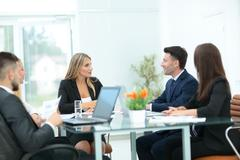 Business people collaborating at the  table Stock Photos