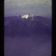 1969: scene of a mountain far away with lots of snow on its peak. LOS ANGELES Stock Footage