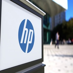 Street signage board with HP Inc. logo. Blurred office center and walking people Stock Footage